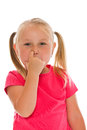 Little girl picking her nose Stock Photos