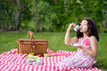 Little girl picnic drinking tea outdoors Royalty Free Stock Photography