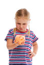 Little girl with piggy bank Royalty Free Stock Images