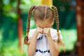 Little girl with pigtails crying Stock Photo