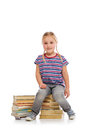 Little girl with a pile of books Royalty Free Stock Image