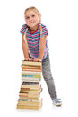 Little girl with a pile of books Stock Photo