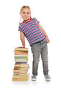 Little girl with a pile of books Stock Images