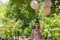 Little girl with pink balllons Royalty Free Stock Image