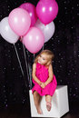 Little girl with pink balloons big bunch of is studio Royalty Free Stock Photos