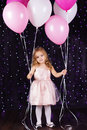 Little girl with pink balloons is studio Stock Images