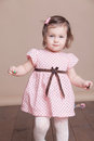 Little girl in a pink dress laughter smile Royalty Free Stock Photo