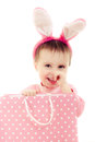 The little girl with pink ears bunny and bag on white background Stock Photo