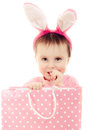 The little girl with pink ears bunny and bag on white background Stock Photography