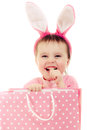 The little girl with pink ears bunny and bag on white background Stock Images