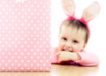 The little girl with pink ears bunny and bag on white background Royalty Free Stock Photo