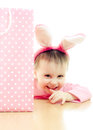 The little girl with pink ears bunny and bag on white background Royalty Free Stock Image