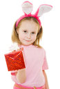 The little girl with pink ears bunny with a gift Royalty Free Stock Images