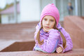 Little girl in pink hat and jacket Stock Photography