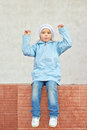 Little girl in pink hat and jacket beautiful white around school building Royalty Free Stock Photos