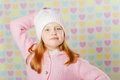 Little girl in a pink hat and a sweater the Royalty Free Stock Photos