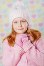 Little girl in a pink hat and a sweater the Stock Photography