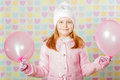 Little girl in a pink hat and a sweater the Royalty Free Stock Image