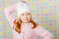 Little girl in a pink hat and a sweater the Stock Photo
