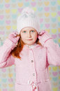 Little girl in a pink hat and a sweater the Stock Photos