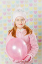 Little girl in a pink hat and a sweater the Royalty Free Stock Photography