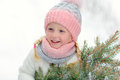 Little girl in a pink hat in winter smiles in the park Royalty Free Stock Photo