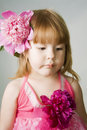 Little girl with pions Stock Photography