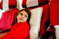 Little girl in a plane scared to fly flying phobia with during air travel flight Royalty Free Stock Photo