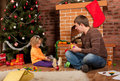 Little girl play with dad  near Christmas tree Royalty Free Stock Photo