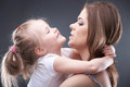 Little girl play with mother kid playing portrait young Royalty Free Stock Photography