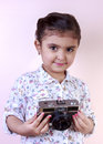 Little girl play with old camera Royalty Free Stock Photo