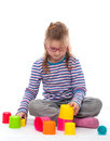 Little girl an play is playing with colorfull building bricks Royalty Free Stock Images
