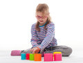 Little girl an play is playing with colorfull building bricks Royalty Free Stock Photo