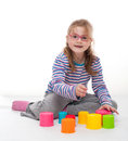 Little girl an play is playing with colorfull building bricks Royalty Free Stock Photography