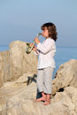 Little girl play saxophone Royalty Free Stock Photo