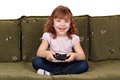 Little girl play video game Royalty Free Stock Images