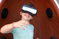 Little girl play video game with virtual reality headset o