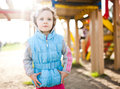 Little girl on playground area happy Royalty Free Stock Image