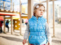 Little girl on playground area pensive Royalty Free Stock Images
