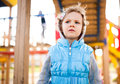 Little girl on playground area pensive Royalty Free Stock Photo