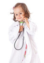 A little girl is playing as a doctor Stock Image