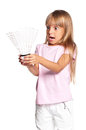 Little girl playing badminton Stock Photos