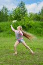 Little girl playing badminton Stock Images