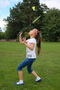 Little girl playing badminton outdoors Royalty Free Stock Image