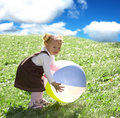 Little girl playing with ball Royalty Free Stock Photo