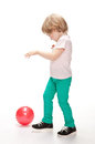 Little girl playing with a ball Royalty Free Stock Image