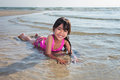 Little girl playing on beach Stock Image