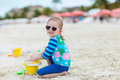 Little girl playing at beach adorable with a toys Stock Photos