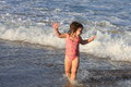 Little girl playing on the beach with her reflection on the water sunshine coast in queensland australia Stock Images