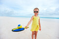 Little girl playing beach tennis Stock Photography